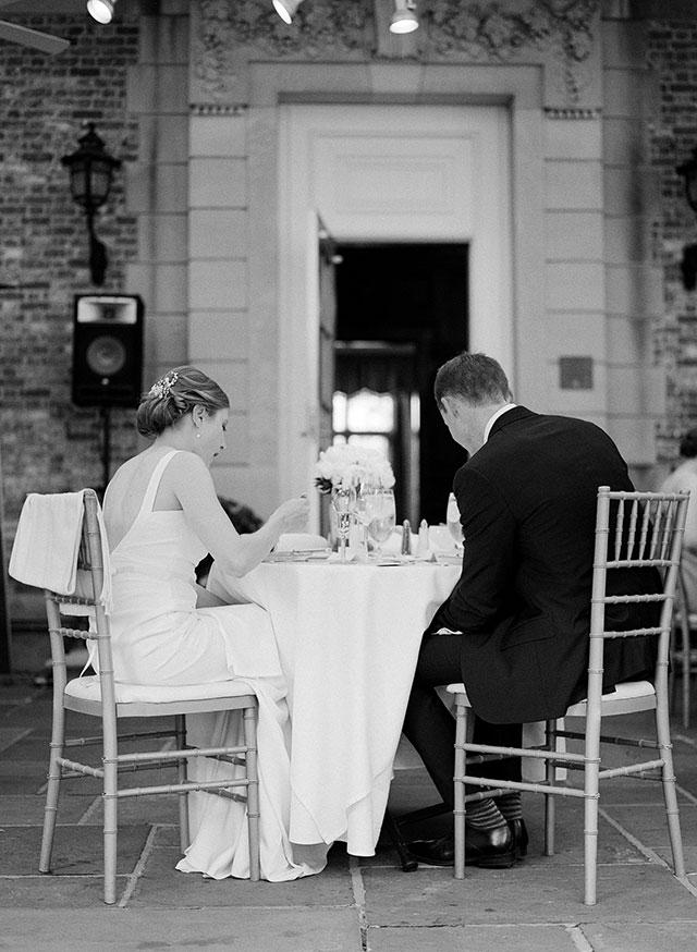 bride and groom enjoying dinner - Sarah Der Photography