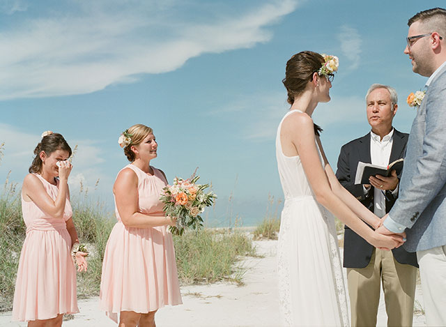 sister wipes away tears during ceremony - Sarah Der Photography
