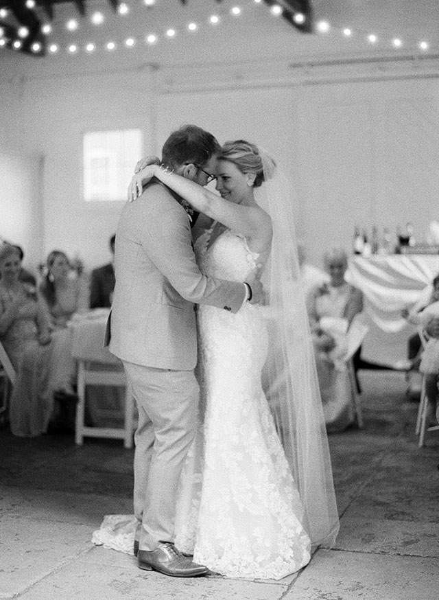 barn reception with string lights - Sarah Der Photography