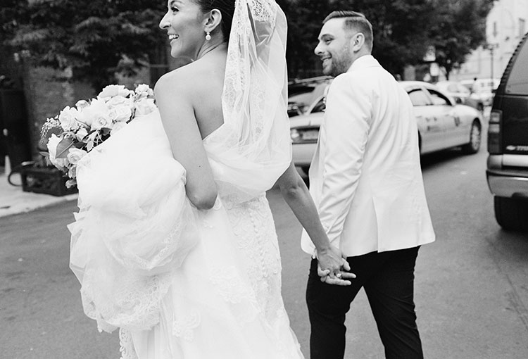 groom with white tux jacket and bride in lace dress - Sarah Der Photography