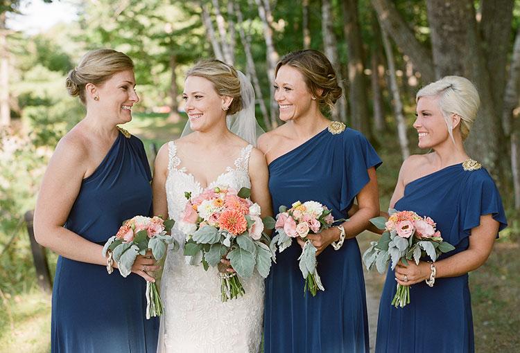 bridesmaids wear mismatching dark blue dresses - Sarah Der Photography