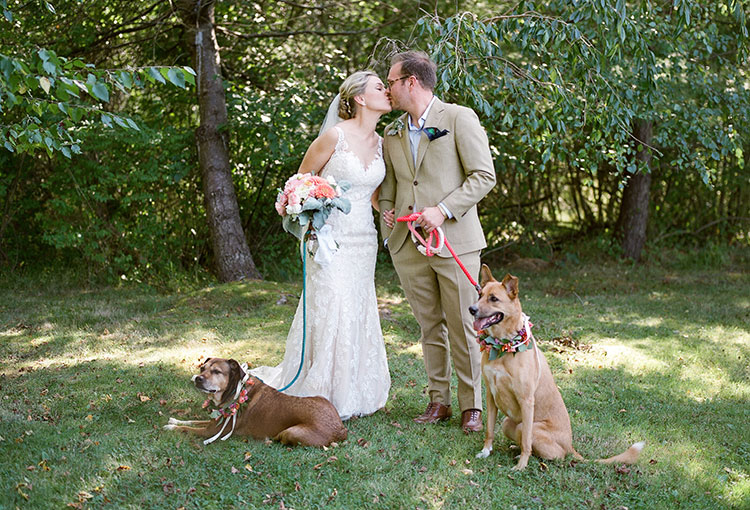 portrait of bride and groom with their dogs - Sarah Der Photography