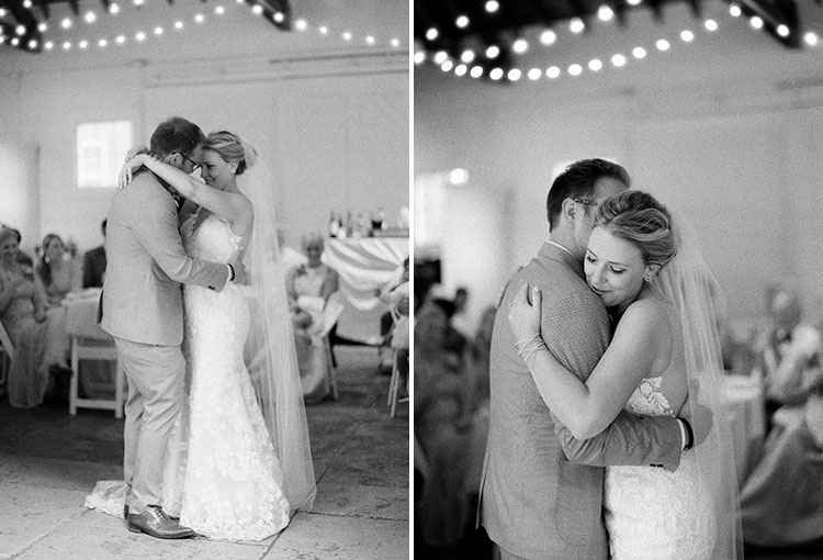 first dance photos shot on black and white film with hanging lights in background - Sarah Der Photography