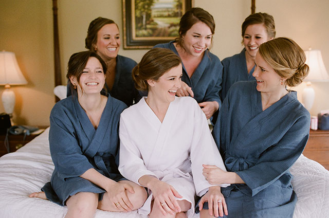 Girls getting ready in robes in bridal suite