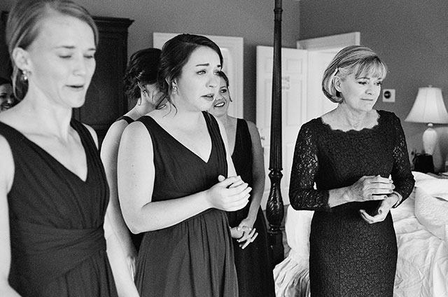 bridesmaids reaction to bride putting on dress