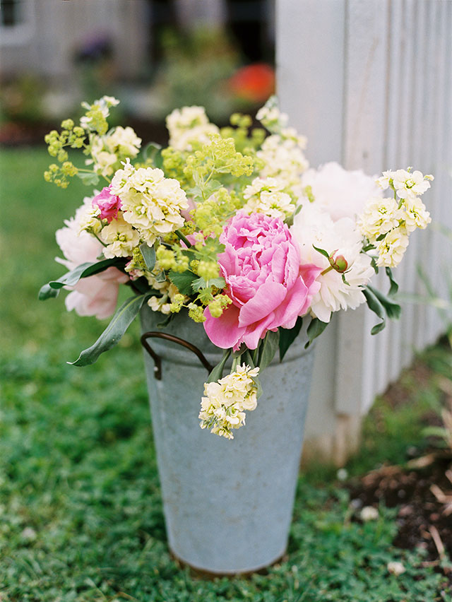 floral arrangement in a tin bucket designed by Michelle Peele.
