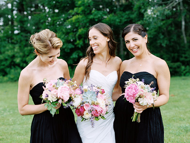 photo of bridesmaids laughing and wearing darn blue bridesmaids dresses