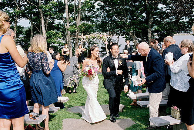 Bride and groom recess down aisle and guests throw lavender grown at Marianmade Farm.
