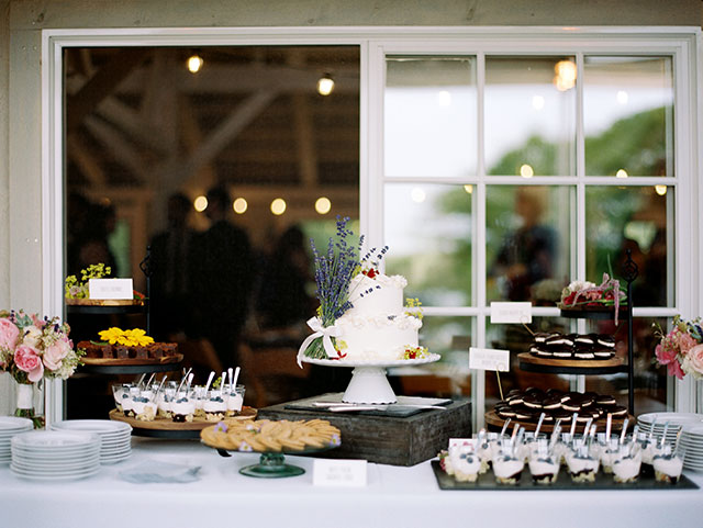 elegant dessert table designed by Trillium Caterers with wedding cake, cookies, and more.