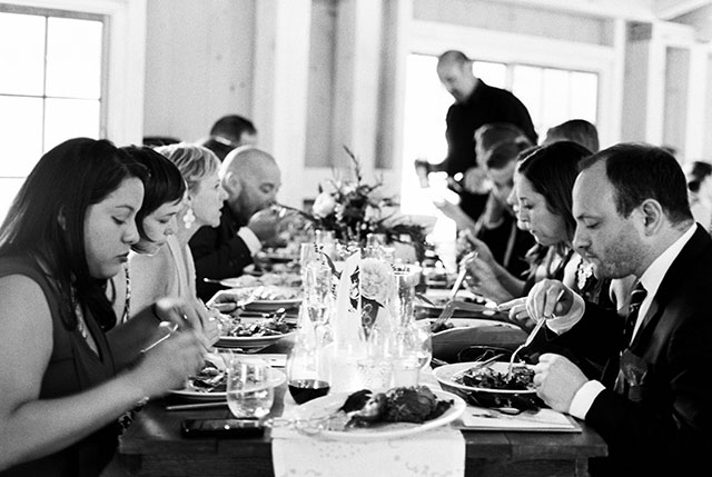 Image of family style wedding reception catering by trillium catering, shot on black and white film.
