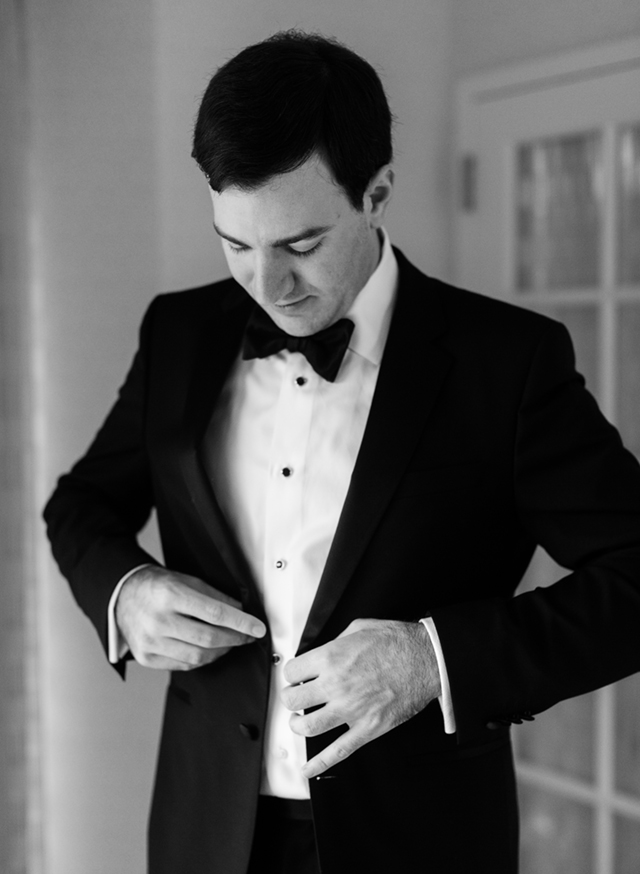 fine art wedding coverage of groom getting ready at the bethesda marriott