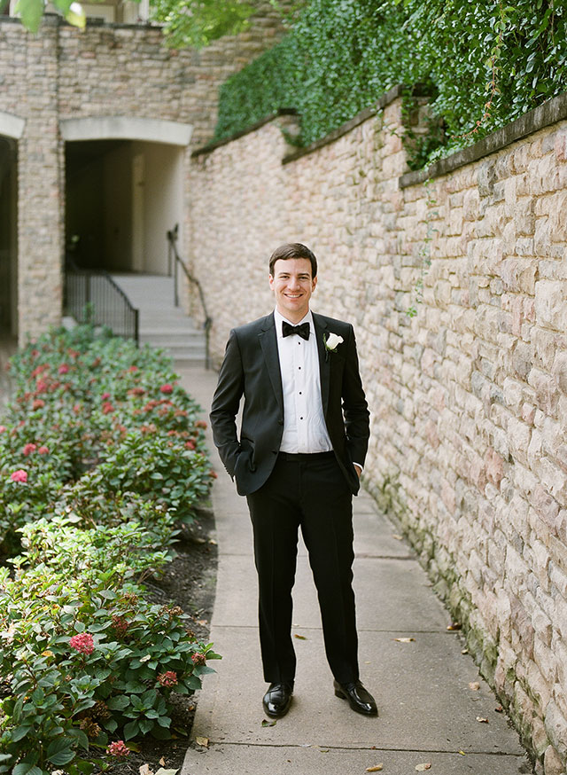 film portrait of groom outside the country club