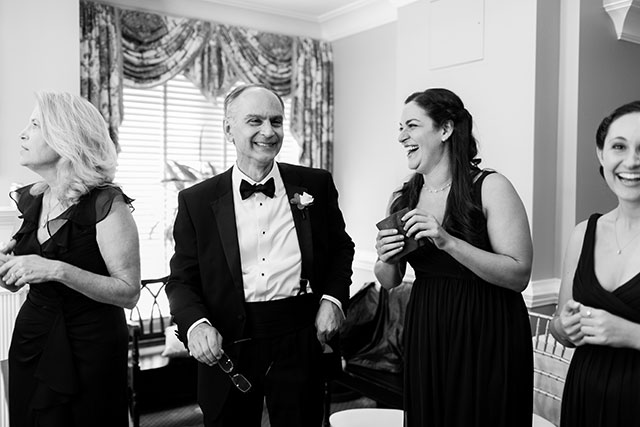 black and white image of family laughing