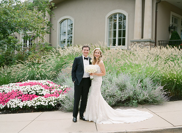 wedding day portraits in front of the bethesda country club