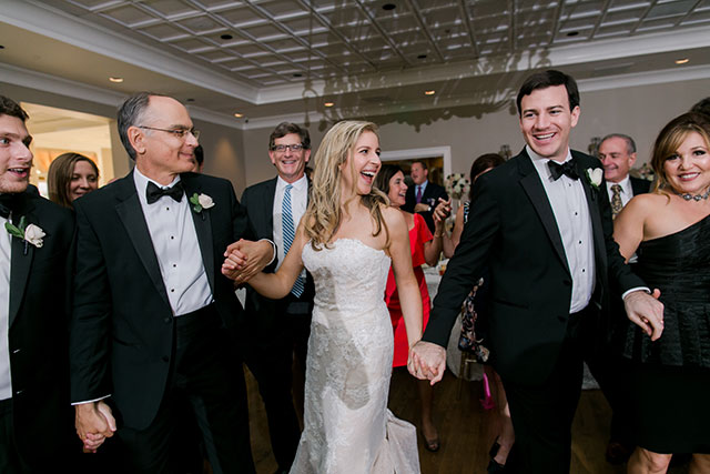 bride and groom dance to the hora