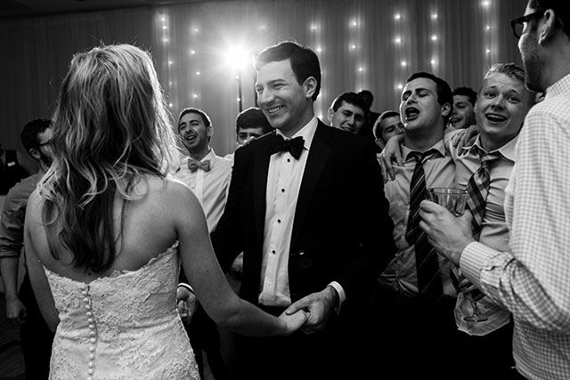 groom laughs at reception