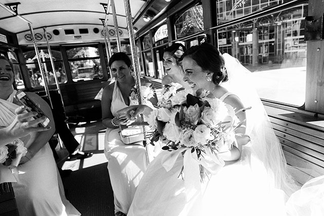 Trolley ride on wedding day through Philadelphia to church for ceremony