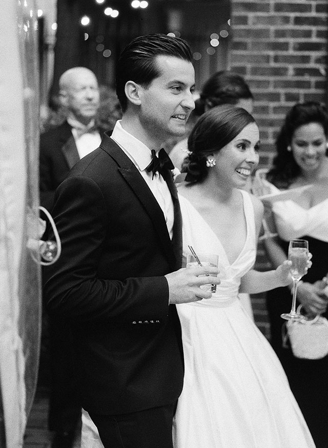 Black and white image on medium format film, of couple hearing toast by best man