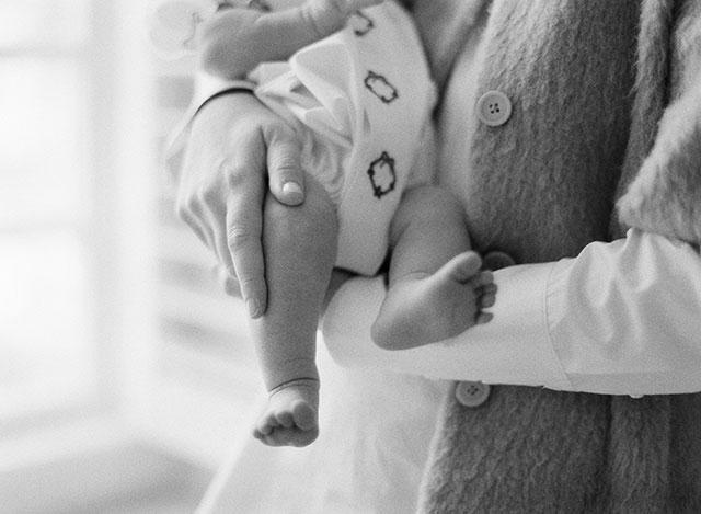 heirloom photo of mother holding newborn