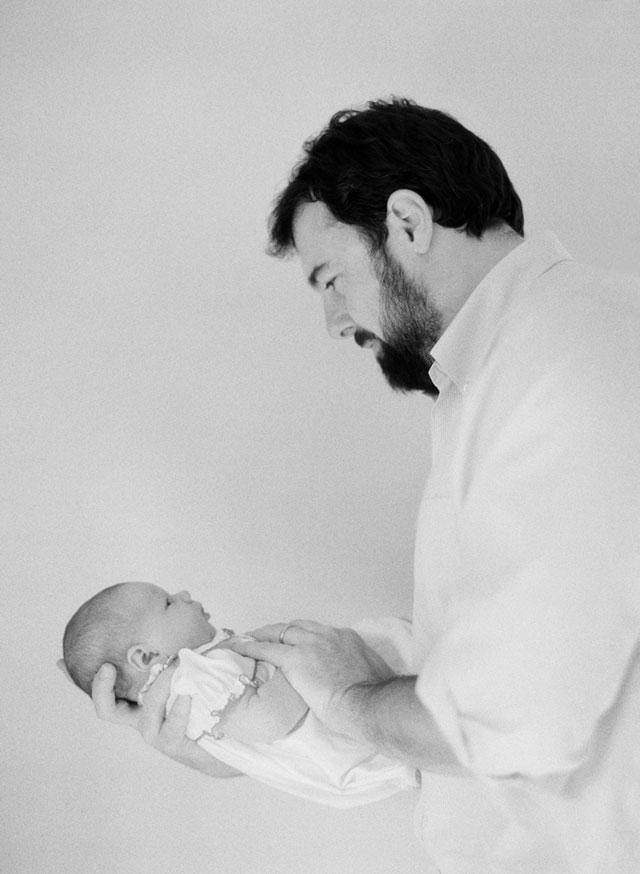 Newborn photographer Sarah Der Photography, photo of father holding newborn