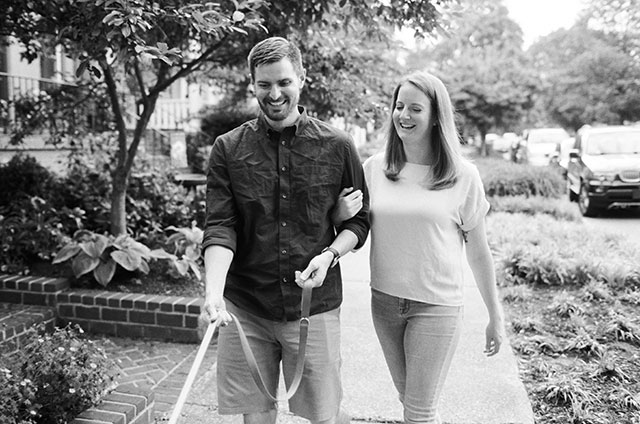 film engagement photo of couple walking dog on black and white ilford XP2 - Sarah Der Photography