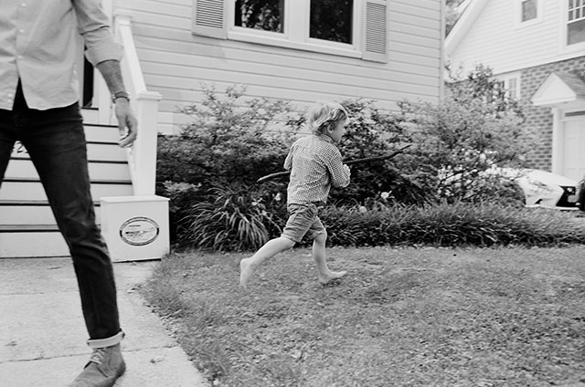 Boy runs through yard barefoot and having so much fun!