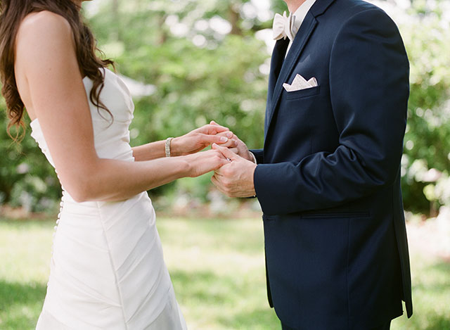 bride and groom holding hands - Sarah Der Photography