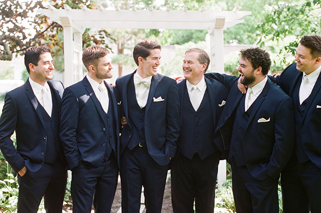 groom and groomsmen laughing - Sarah Der Photography