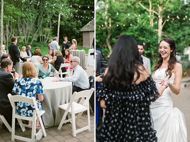 guests sitting at tables outside the barn eating and drinking - Sarah Der Photography