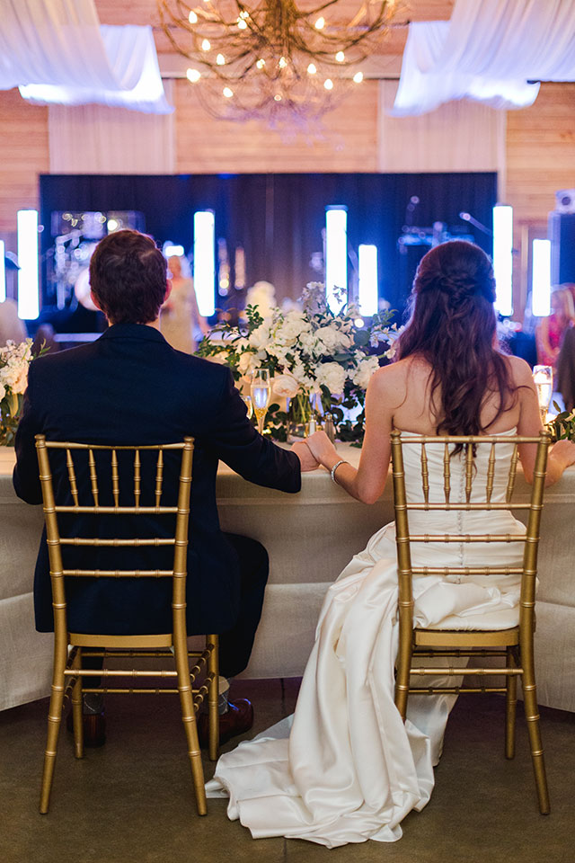 shot of couple holding hands at sweetheart table - Sarah Der Photography