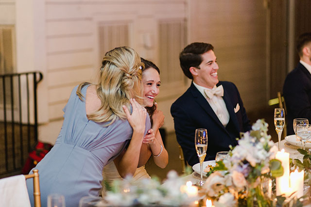 maid of honor hugs bride and bride smiles - Sarah Der Photography