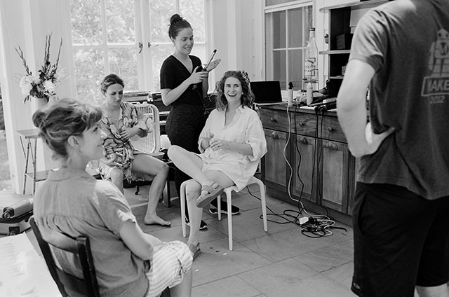 black and white candid image of bride getting ready for wedding - Sarah Der Photography
