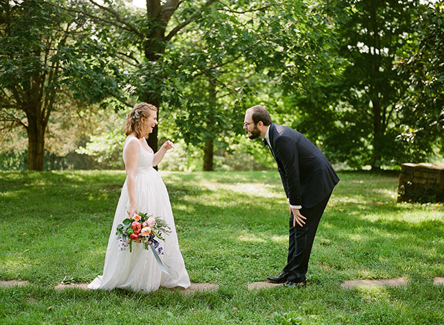 Adorable first look photo of groom surprised and bride laughing - Sarah Der Photography