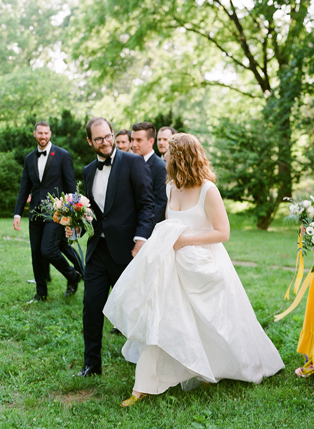 bride and groom walk  - Sarah Der Photography