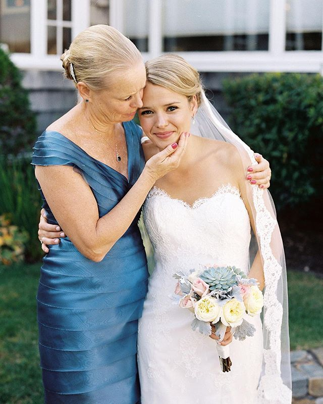A sweet, unprompted moment between the bride and her mother. Isn't it kind of crazy to think, this is just 1/500th of second or so?! The tiniest split second of a moment captured on film?! Photography is amazing, I think...! #film #sarahderphotography #weddingday
