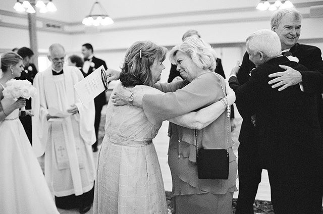 I love this photo, it is easily one of my favorites! The bride's mother and the groom's mother, right after the wedding ceremony, embracing. And in the background, the fathers hugging as well, the bride talking to the minister about signing the marriage certificate. There is such a joyful, sweet story being told! #film #rvawedding #richmondwedding #richmondweddingphotographer #sarahderphotography #virginiaphotographer #virginiawedding #virginiaweddingphotographer