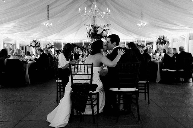 A sweet kiss shared during this couple's intimately lit reception. All of their friends and family gathered in one place, celebrating the start of their marriage together. 💞#sarahderphotography #reception #weddingreception