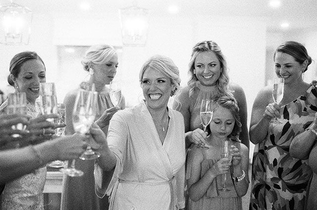 bride and friends sheers with champagne
