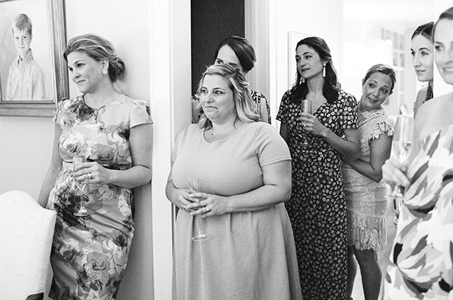 bridesmaids and friend watch with sweet expressions