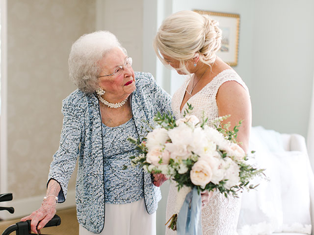 candid moment between bride and grandmother