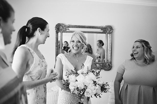 Bride smiles and is excited for wedding ceremony