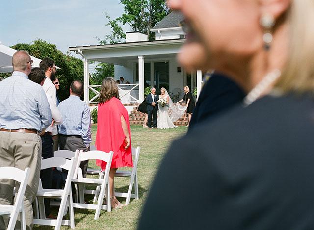 Bride walks down aisle  by Sarah Der