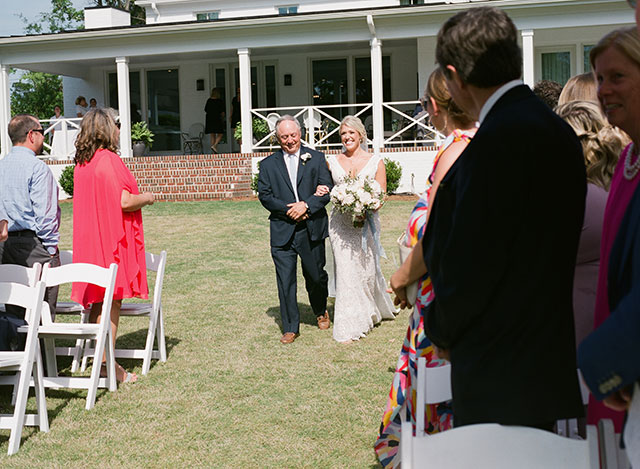 Outdoor wedding ceremony on the golf course by Sarah Der