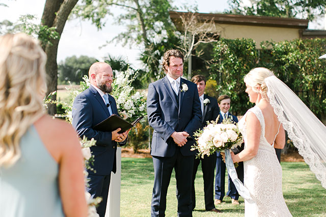 Groom sees bride and smiles  by Sarah Der
