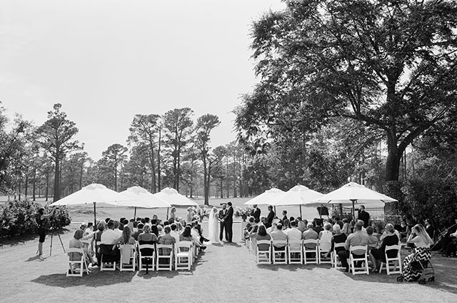 Black and white film photo of wedding ceremony overlooking cape fear country club by Sarah Der
