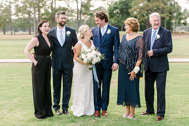 Candid and sweet family formal of groom's family by Sarah Der