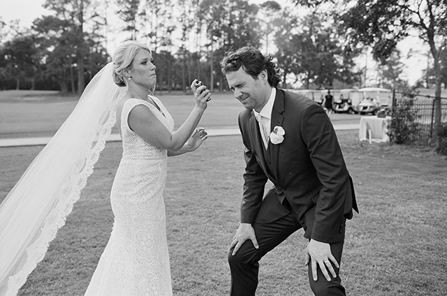 Candid moment of bride fixing groom's hair with hairspray  by Sarah Der