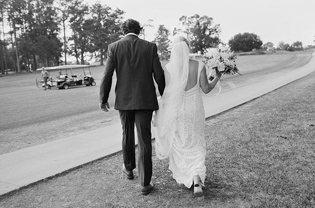 Couple walks to golf cart