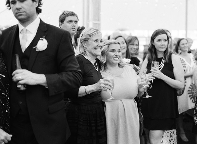 Candid meaningful wedding photography, mom smiling watching first dance By Sarah Der