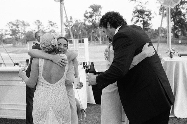 Couple hugs guests